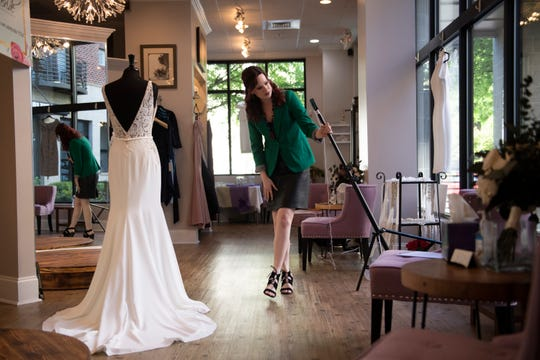 Olivia Medley shows dresses to a client over video at The Poinsett Bride Thursday, April 16, 2020. Do to concerns from COVID-19, the store is using new methods to help brides shop, including virtual fittings.