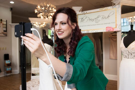 Olivia Medley sets up a video call to do a virtual fitting with a client at The Poinsett Bride Thursday, April 16, 2020. Do to concerns from COVID-19, the store is using new methods to help brides shop, including virtual fittings.
