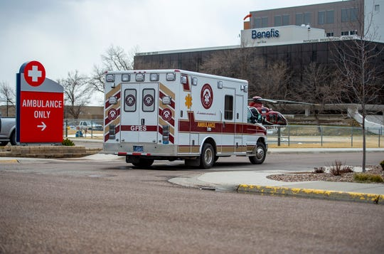An ambulance arrives at the Benefis Hospital emergency department, Wednesday, April 15, 2020.