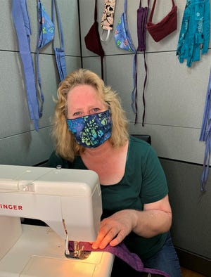 Barbara Mafnas makes face masks to help people stay safe during the COVID-19 pandemic.