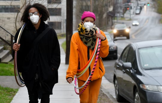 Pedestrians on State St. in downtown Ithaca. New York state now requires that people wear face masks in public when social distancing is not possible. Scenes from around Tompkins County as the New York state enters a second month of state mandated restrictions due to COVID-19. April 17, 2020.