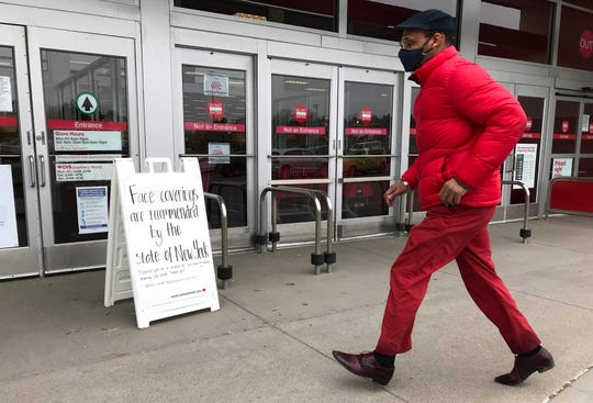 A sign at Target at The Shoppes at Ithaca Mall alerts shoppers that face masks should be worn. Scenes from around Tompkins County as the New York state enters a second month of state mandated restrictions due to COVID-19. April 17, 2020.