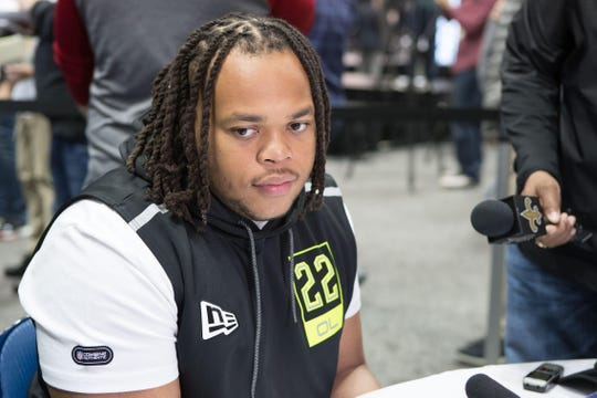 UL offensive linemen speaks with reporters at the 2020 NFL Draft Combine in Indianapolis.