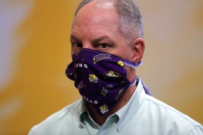 Louisiana Gov. John Bel Edwards wears a face mask as he visits a production site on the LSU campus in Baton Rouge, La., where the school is manufacturing personal protection equipment for hospitals in response to the coronavirus pandemic Friday, April 17, 2020.