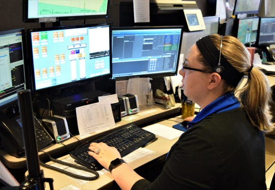 Jenna Webster, a communication technician, takes a service call for the Lancaster Fire Department Thursday, April 16. She started as a dispatcher for the city's safety services in February.