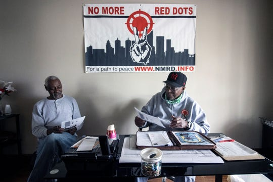 Dr. Eddie Woods of No More Red Dots chats with Bobby Blackford on Friday at the program's Portland headquarters. 4/17/20