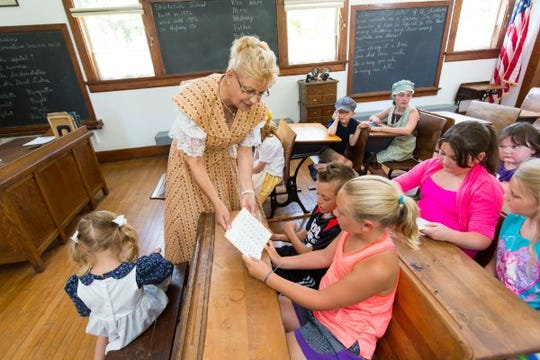 Cheryl Bauer, a Manitowoc County Historical Society volunteer, plays the role of the Shadyside School teacher.