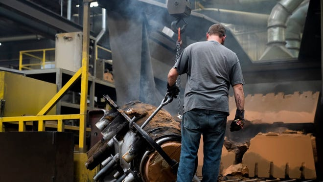A worker stays on the job at Wisconsin Aluminum Foundry in Manitowoc, while the state and national economy face a crisis amid the coronavirus pandemic.