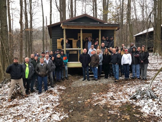 Warren Rupp employees built two new cabins at Friendly House's Happy Hollow Day Camp this past year.