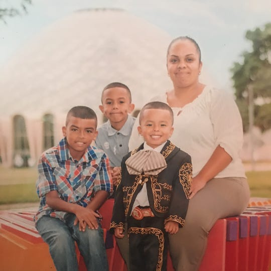 From left to right: William Perez-Mendez, 13, Juancarlos José, 12, and Jerónimo José, 8, with their mother, Darlene José.