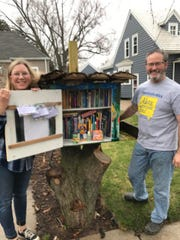 Carleen Lawrynk and her boyfriend, Mark Lampereur, make face masks on sewing machines and put them in their Little Free Libraries on Green Bay's west side for anyone to take during the coronavirus pandemic.