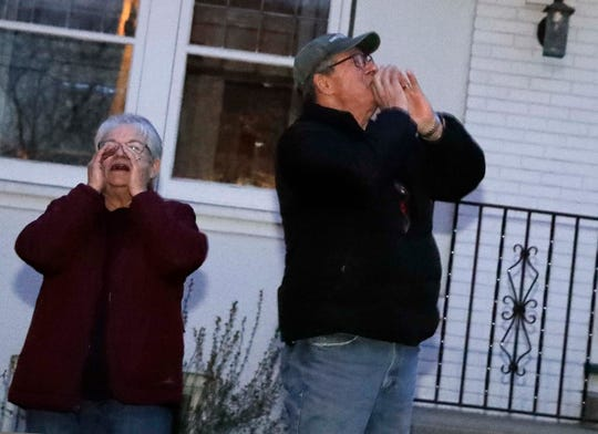 """Bob and Shelia Gostisha have organized  a nightly """"howl"""" which occurs at 8 pm across Wauwatosa every night."""