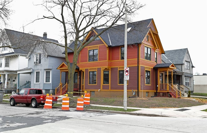 The City of Milwaukee planned to raze this house at 3405 W. St. Paul Ave. before it was restored. Ald. Robert Bauman wants the city to freeze demolitions while considering ways to salvage other homes.