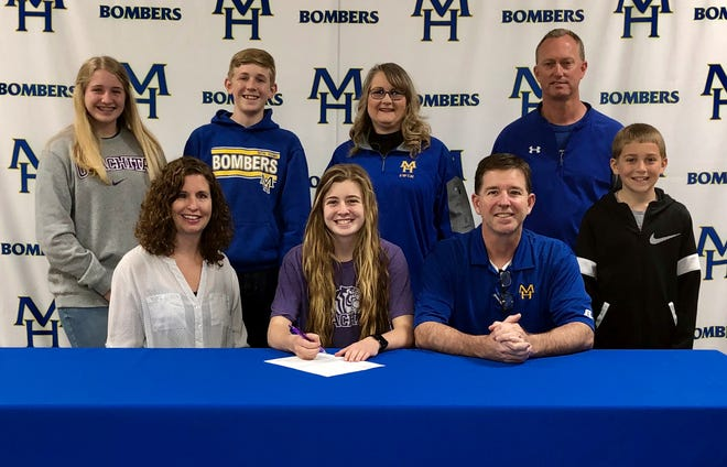Mountain Home's Bella Bevel signed a National Letter of Intent to swim at Ouachita Baptist University on Friday. Pictured at the signing are (front row, from left) Ann-Marie Bevel, Bella Bevel, Bobby Bevel, David Bevel, (second row) Victoria Bevel, William Bevel, MHHS swim coach Kathy Wham, and MHHS athletic director Mitch Huskey.