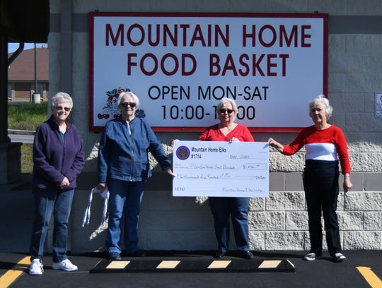The Mountain Home Elks Lodge made a $1,500 donation to the Mountain Home Food Basket on Wednesday. Shown above (from left) are Kay Owens, food drive coordinator for the Food Basket; Lana Ellibee, Elks grant coordinator; Debbye Barreda, food buyer for the Food Basket;  and Sherie Brown, Elks Exalted Ruler.