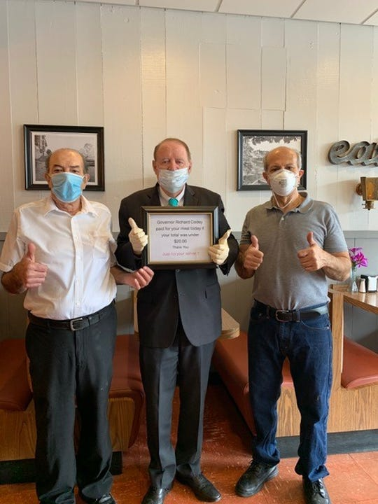 Former New Jersey Governor and current District 27 Sen. Richard Codey, center, with Jim and Chris Paxos, owners of the Plaza Restaurant at Del''s Village Shopping Center in Boonton, currently limited to takeout and curbside pickup during the coronavirus pandemic. Codey is holding a sign pledging he will pay for your meal, up to $20, on Monday, April 17, 2020.