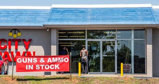 A guns and ammo in stock sign at City Pawn in Montgomery, Ala., on Tuesday April 14, 2020.