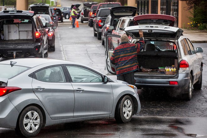 Hundreds of drivers line up for food assistance during a Second Harvest tailgate at First Baptist Church in New Castle Friday, April 17, 2020.