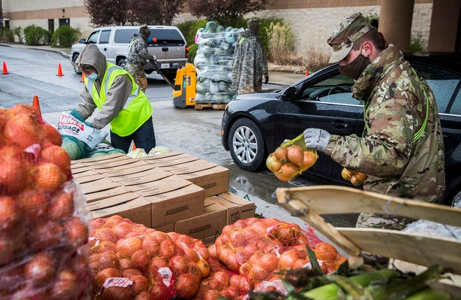 National Guard soldiers were tasked with providing assistance during a Second Harvest tailgate at First Baptist Church in New Castle Friday, April 17, 2020. The National Guard has been helping the non profit battle food insecurity locally since the beginning of April.