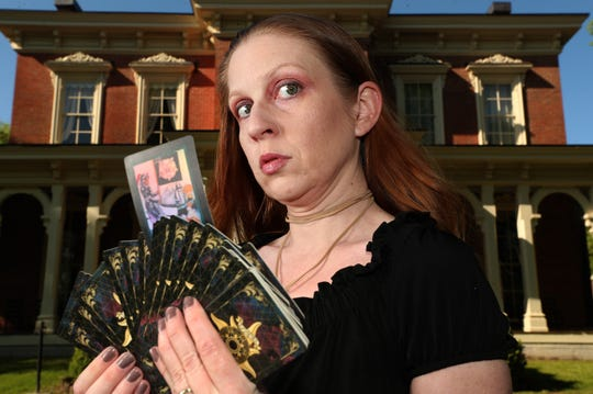 """Jess Townsend gets into her character, fortune teller Zilpha Marsh, for the play """"Spoon River Anthology"""" at Oaklands Mansion, on Thursday, April 16, 2020, in Murfreesboro. Townsend holds up the Death card from a tarot deck, since all of the characters are remembering their lives after they have died. The Murfreesboro Little Theatre will be doing a virtual production of the play."""