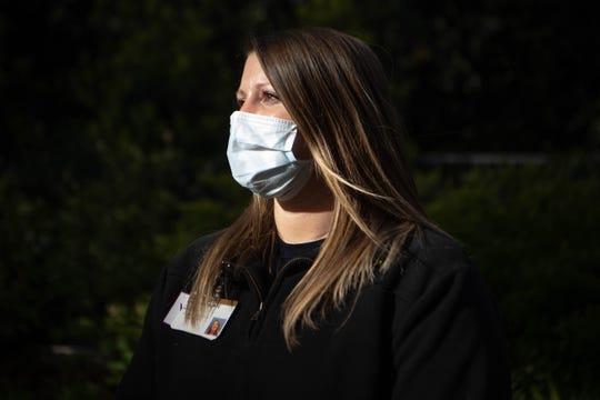 Athletic trainer Kayla Fiveash poses for a photo outside of Vanderbilt University Medical Center Friday, April 17, 2020, in Nashville, Tenn.
