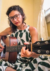 Singer and songwriter Sarah Quintana performs an online concert from her home.