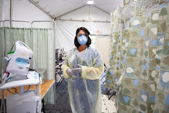 NCH Healthcare System RN Tracy Rogers provides a tour of the triage tent Friday, April 17, 2020, at NCH Baker Hospital in Naples. Nurse Rogers is the acting COVID-19 screener at NCH Baker Hospital.