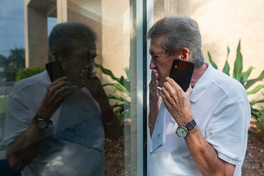 Bob Duross blows kisses to his wife, Sharon Duross, at Solaris Senior Living in North Naples before leaving for home in Ave Maria, Friday, April 17, 2020. Duross is able to visit his wife three days a week for 15 minutes.