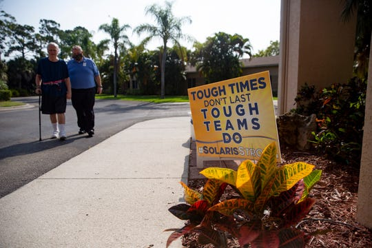 Resident Fred Grunst gets his morning exercise with Solaris Senior Living  therapy director Darrin Brooks, Friday, April 17, 2020, at Solaris Senior Living in North Naples.
