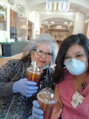 Two local women enjoy free coffee on the house from Plateau Espresso which offered them free drinks to show appreciation to health care workers on Friday morning. Courtesy photo.