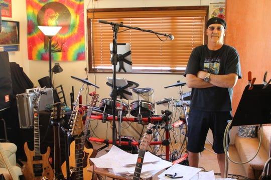 Jose Villarreal poses in the studio of his Farmington home.