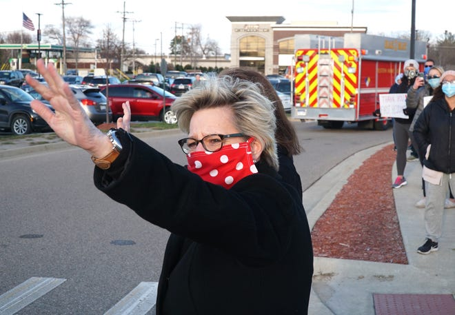 Mayor Maureen Miller Brosnan is often seen sporting her red and white homemade face mask.