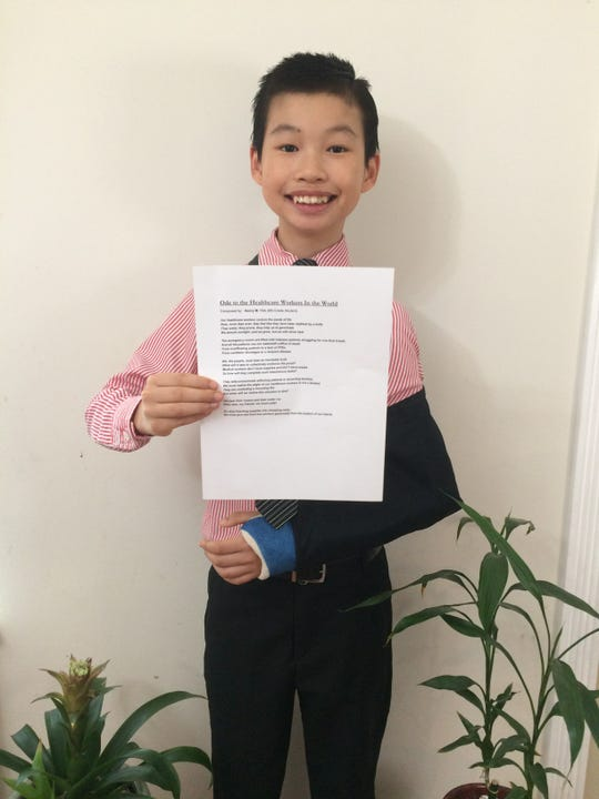 """Henry Yim with his poem, """"Ode to the Healthcare Workers of the World,"""" dedicated to those fighting the coronavirus pandemic."""