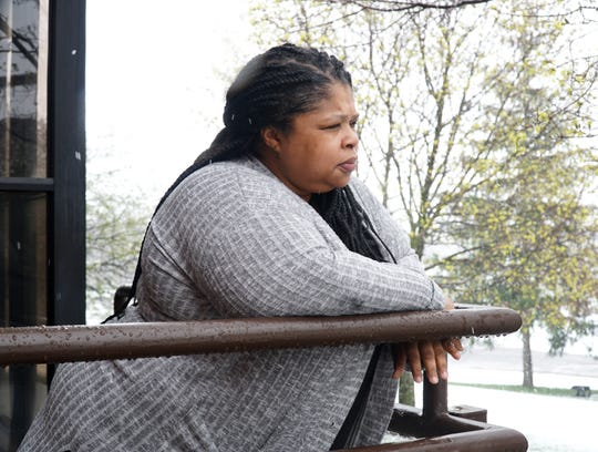 Samaritas homeless shelter director Tamieka                           Andrews pauses outside its Michigan Avenue building on April 17, 2020.