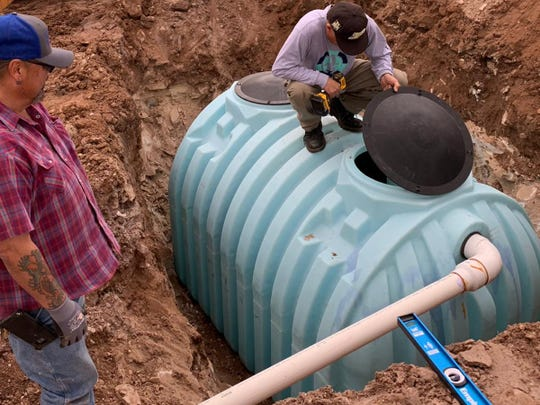 Workers for DigDeep's Navajo Water Project prepare an underground 1,200-gallon water cistern to provide a family with running water in their home.