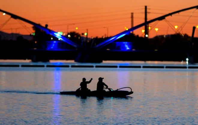 Kayakers paddle on Tempe Town Lake on April 16, 2020.