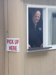 Lou Olsen, owner of Luigi's Italian Imports in Highland, constructed a drive-thru for customers to pick up their orders.