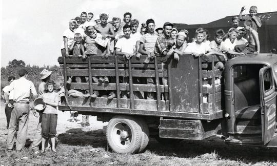 One of several truckloads of workers returning from the fields in 1948.