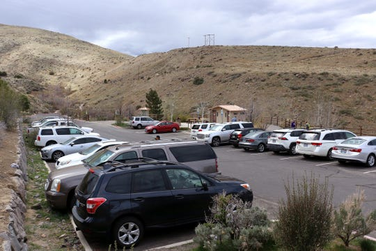 Cars are seen filling the parking lot at the Michael D. Thompson Trailhead in Reno on April 17, 2020.
