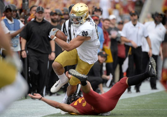 Notre Dame wide receiver Chase Claypool is tackled by Iowa State defensive back Braxton Lewis (33).