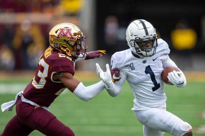 Penn State Nittany Lions wide receiver KJ Hamler (1) rushes with the ball past Minnesota Golden Gophers defensive back Jordan Howden (23).