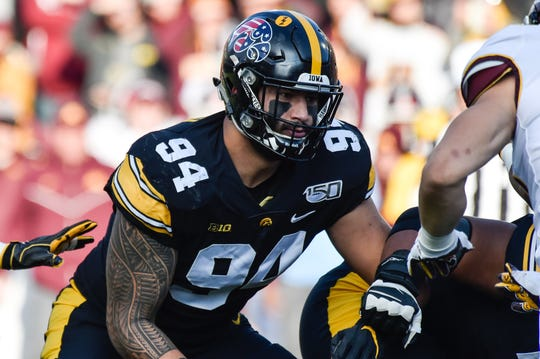 Iowa Hawkeyes defensive end A.J. Epenesa (94) in action against the Minnesota Golden Gophers.