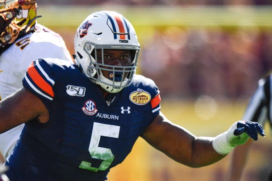 Auburn Tigers defensive tackle Derrick Brown (5) rushes the passer during the first quarter against the Minnesota Golden Gophers at Raymond James Stadium.