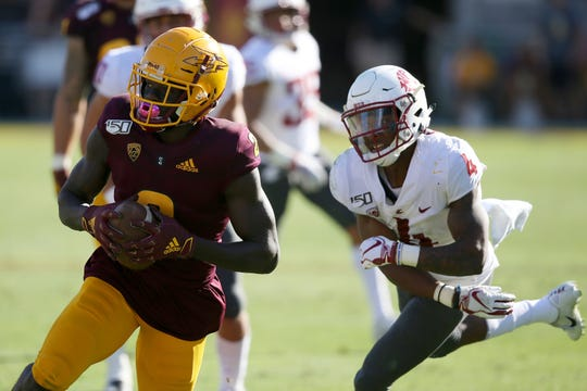 Arizona State wide receiver Brandon Aiyuk, left, runs with the ball after making a catch in front of Washington State cornerback Marcus Strong (4).