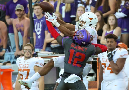 TCU Horned Frogs cornerback Jeff Gladney (12) defends a pass intended for Texas Longhorns wide receiver Collin Johnson (9).