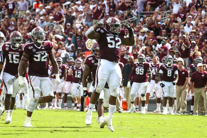 Texas A&M Aggies defensive lineman Justin Madubuike (52) celebrates after making a sack during the second quarter against the Auburn Tigers.
