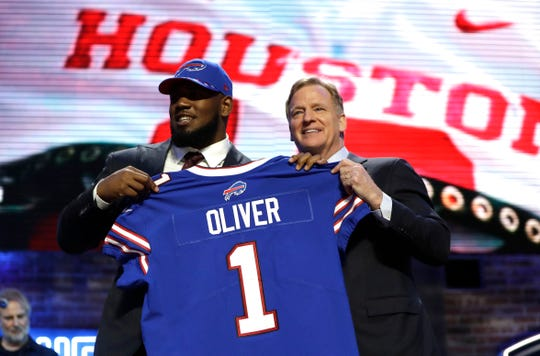 Houston defensive tackle Ed Oliver poses with NFL Commissioner Roger Goodell after the Buffalo Bills selected Oliver in the first round at the NFL football draft, Thursday, April 25, 2019, in Nashville, Tenn. The 2020 NFL Draft begins Thursday, April 23, and will be conducted virtually.