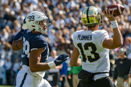 Penn State Nittany Lions defensive end Yetur Gross-Matos (99) pressures Purdue Boilermakers quarterback Jack Plummer (13).