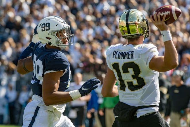 Penn State Nittany Lions defensive end Yetur Gross-Matos (99) pressures Purdue Boilermakers quarterback Jack Plummer (13).