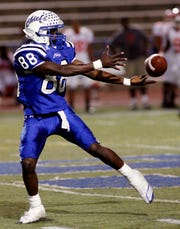 Lake View High School's J.D. Smith reaches back for a pass in a 2010 game against Waco High.